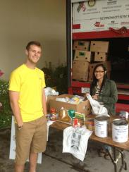 Alex and Jordyn helping at the donations table.