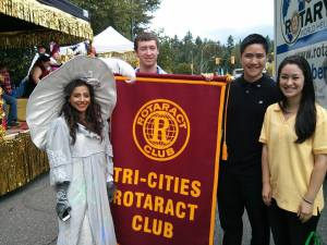 Rasmeet, Chris, Eric and Kimberley representing our club in the parade.