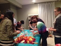 Stuffing candy bags at our meeting to give to the guests.